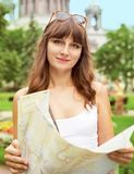 Portrait of happy young tourist girl with the map Royalty Free Stock Image