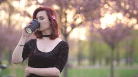 Portrait of Happy young travel dancer woman enjoying free time in a sakura cherry blossom park - Caucasian white redhead stock video footage
