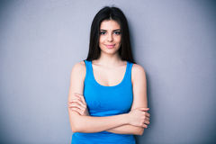 Portrait of a happy young woman with arms folded Royalty Free Stock Photo