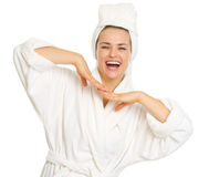 Portrait of happy young woman in bathrobe Royalty Free Stock Photography