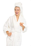 Portrait of happy young woman in bathrobe Stock Photography