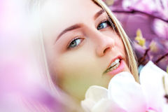 Portrait of happy young woman in blooming flowers Royalty Free Stock Images