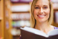 Portrait of happy young woman with book Royalty Free Stock Photography