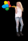 Portrait of a happy young woman with a bundle of balloons Stock Image