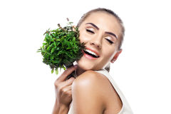 Portrait of happy young woman with a bundle of fresh mint Stock Images