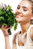 Portrait of happy young woman with a bundle of fresh mint Royalty Free Stock Photography