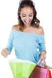 Portrait of happy young woman carrying shopping bags Stock Image