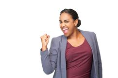 Portrait of a happy young woman celebrating with fist pump Royalty Free Stock Image