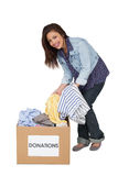 Portrait of a happy young woman with clothes donation Royalty Free Stock Photos