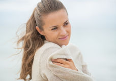 Portrait of happy young woman on cold beach Royalty Free Stock Images