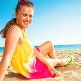 Portrait of happy young woman in colorful dress on beach Royalty Free Stock Images