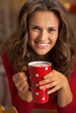 Portrait of happy young woman with cup of hot chocolate Stock Photos