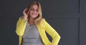 Happy woman dancing in studio stock video
