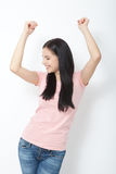 Portrait of happy young woman dancing on white background Royalty Free Stock Photography