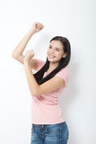 Portrait of happy young woman dancing on white background Stock Photos