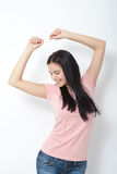 Portrait of happy young woman dancing on white background Stock Photography