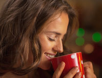 Portrait of happy young woman drinking hot chocolate Royalty Free Stock Photo