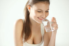 Water. Happy  Woman Drinking Water Royalty Free Stock Images