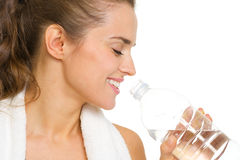 Portrait of happy young woman drinking water Stock Photos