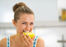 Portrait of happy young woman eating apple Royalty Free Stock Photo