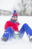 Portrait of happy young woman enjoying sled ride in snow Stock Photography