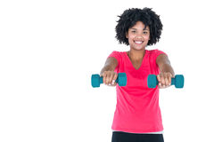 Portrait of happy young woman exercising with dumbbells Royalty Free Stock Photo