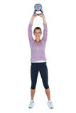 Portrait of happy young woman exercising with kettlebell Stock Photo