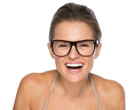 Portrait of happy young woman in eyeglasses looking in camera Stock Photo