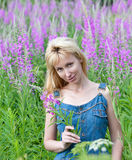 Portrait of the happy young woman in flowers Royalty Free Stock Photography