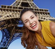 Portrait of happy young woman in front of Eiffel tower in Paris Stock Images