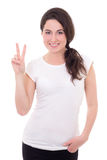 Portrait of happy young woman giving peace sign isolated on whit Royalty Free Stock Photo