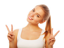 Portrait of happy young woman giving peace sign Stock Images
