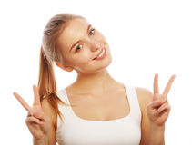 Portrait of happy young woman giving peace sign Royalty Free Stock Photo