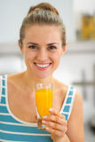 Portrait of happy young woman with glass of juice Stock Images