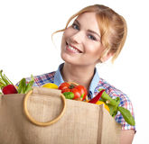 Portrait of happy young woman holding a bag royalty free stock images