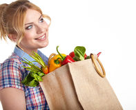 Portrait of happy young woman holding a  bag Royalty Free Stock Photography