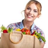 Portrait of happy young woman holding a bag royalty free stock photos