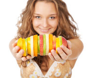 Portrait of happy young woman holding   fruits Royalty Free Stock Photo