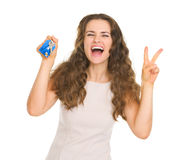 Portrait of happy young woman holding house key Royalty Free Stock Photography