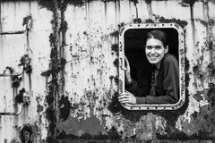Portrait of happy young woman in industrial zone. Stalkers, abandoned objects Stock Photo