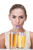 Portrait of happy young woman with juice Royalty Free Stock Photography