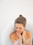 Portrait of happy young woman laying in bathtub Stock Photography