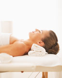Portrait of happy young woman laying on massage table Royalty Free Stock Image