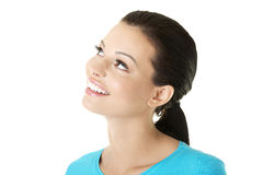 Portrait of a happy young woman looking up Stock Photo