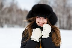 Portrait of happy young woman in luxury fur hat Stock Photo
