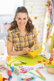 Portrait of happy young woman making easter basket Stock Photo