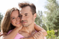 Portrait of happy young woman with man in park Stock Photography
