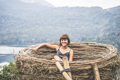 Portrait of happy young woman on the mountains background. Tropical island Bali, Indonesia. Lady in travel. Royalty Free Stock Image