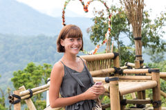 Portrait of happy young woman on the mountains background. Tropical island Bali, Indonesia. Lady in travel. Royalty Free Stock Images