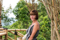 Portrait of happy young woman on the mountains background. Tropical island Bali, Indonesia. Lady in travel. Stock Photo